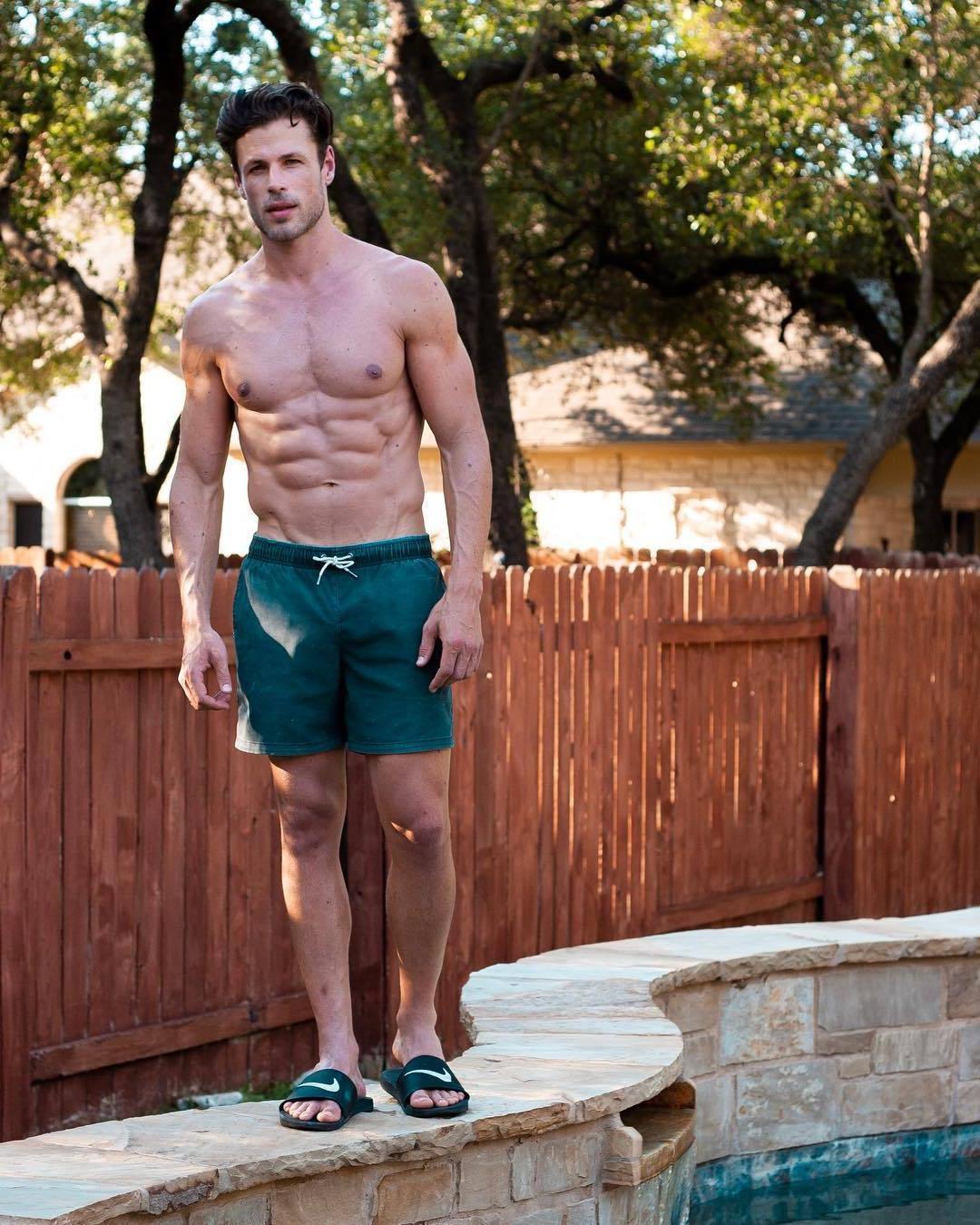 handsome-shirtless-man-big-pecs-ripped-abs-green-shorts