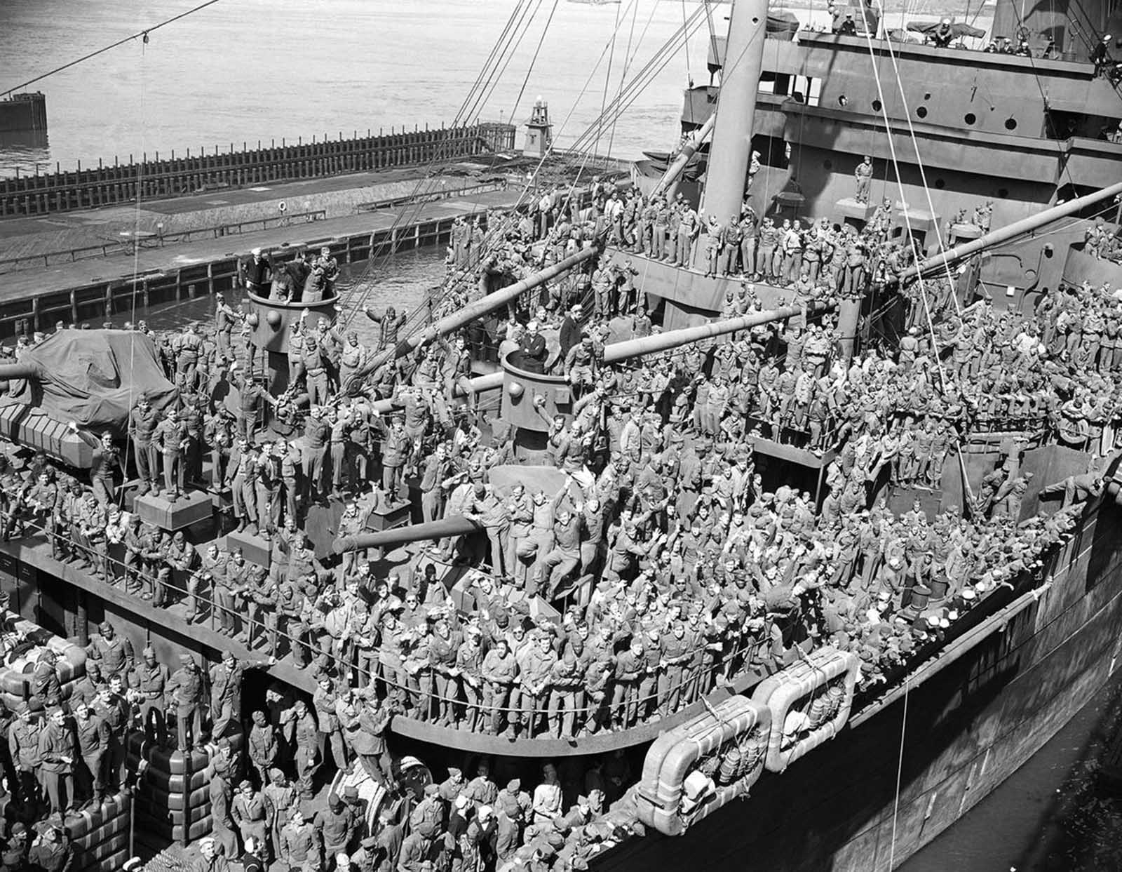 The super transport ship, General W.P. Richardson, docked in New York, with veterans of the European war cheering on June 7, 1945. Many soldiers were veterans of the African campaign, Salerno, Anzio, Cassino and the winter warfare in Italy's mountains.