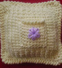 http://www.ravelry.com/patterns/library/tunisian-keepsake-pocket-pillow