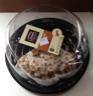A blurry image of L'Oven Fresh Cinnamon Crumb Cake, in its packaging