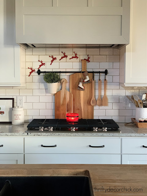 white subway tile gray vent hood