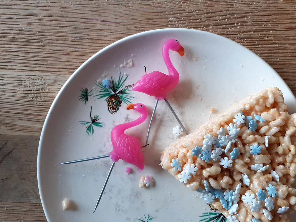 Rice Krispie cake with flamingo candles
