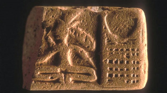 Horned deity sitting beside a structure, Harappa molded tablet H95-2487/4466-02