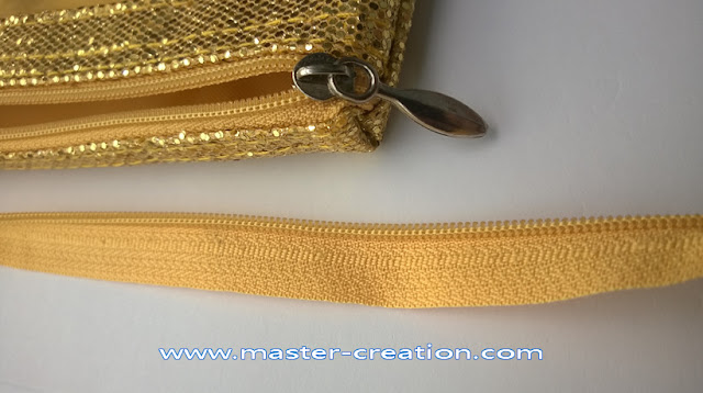 gold sequin bag with zipper in matched color