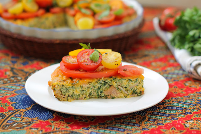 Food Lust People Love: This tomato salad topped baked spinach frittata is a delicious combination of richness from the eggs, ham and cheese and the sharp sweetness of the tomatoes with herbs. It makes a wonderful brunch, lunch or dinner dish!