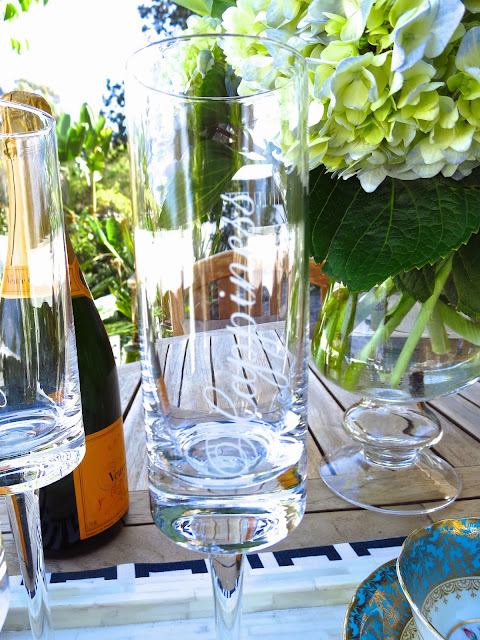 "Whimsical champagne flutes with the word ""Happiness"" written on them"