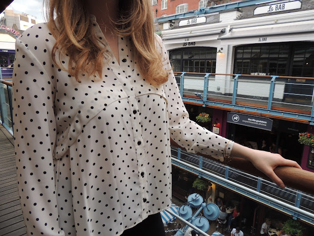 close up of Topshop polka dot shirt