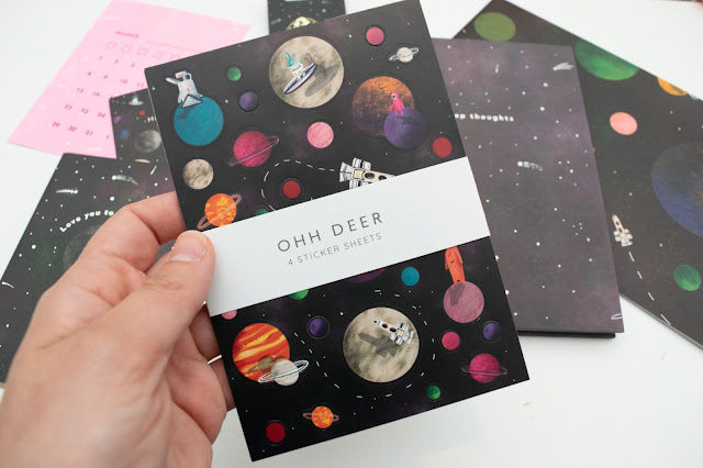 Space themed sticker sheets with planets, astronauts and aliens