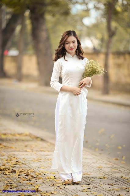 Vietnamese teen girl walking on the street with white ao dai 1