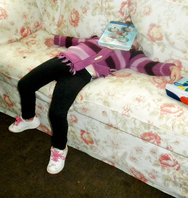 15+ Hilarious Pics That Prove Kids Can Sleep Anywhere - Napping With A Game On A Face