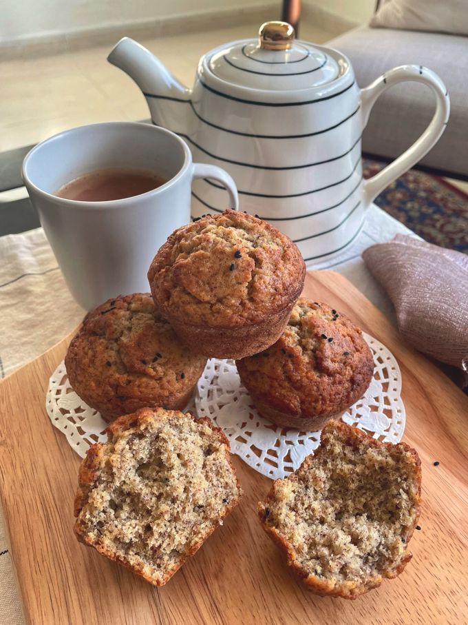muffins served with a mug of chai beside a kettle