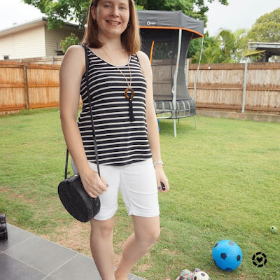 awayfromtheblue Instagram | monochrome black white striped tank bermuda denim shorts outfit with straw bag