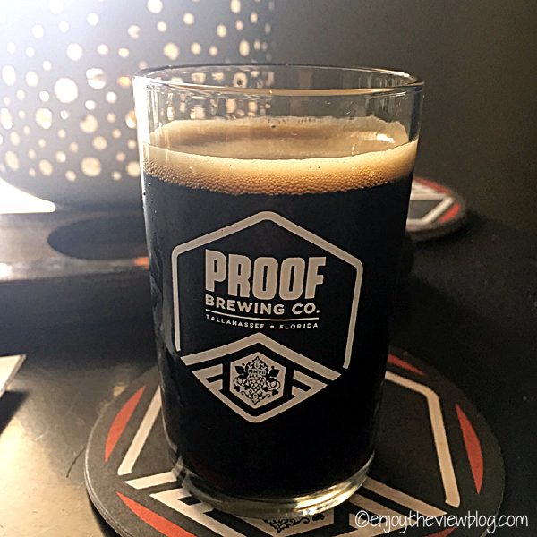 Creatures in the Dark stout at Proof Brewing in Tallahassee is delicious! #adventuresofgusandkim #travelover50 #wheretodrinkinTallahassee #enjoytheviewblogtravel #craftbeer