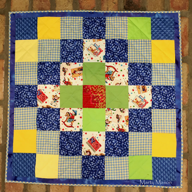 a quilt for community service - Marty Mason