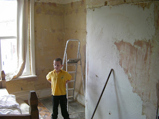 stripping wallpaper and sweeping up