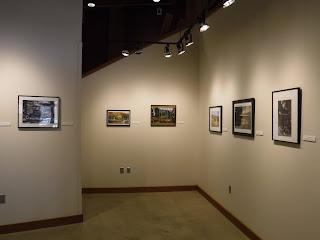 mounted and framed 8x10 photos from the Sioux City Camera Club are lined up at eye height in the main gallery at the Betty Strong Encounter Center