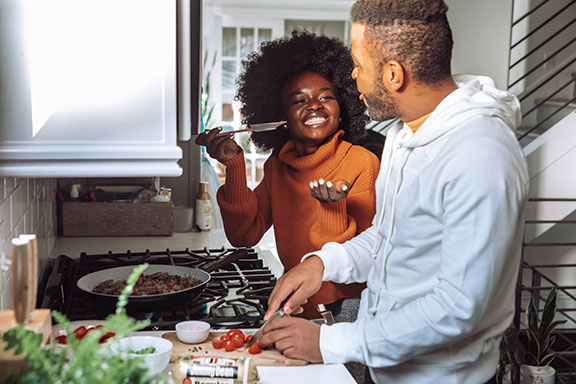 Two people cooking in a kitchen
