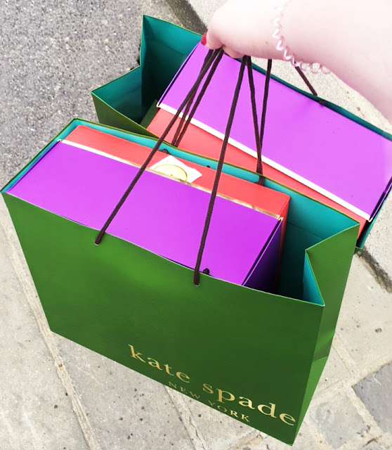 Kate Spade outlet Store high end designer shop Bicester Village shopping centre purchases