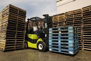 Forklift Hauling Pallets