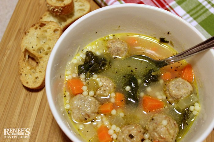 Easy Italian Wedding Soup by Renee's Kitchen Adventures in a bowl with bread croutons on the side