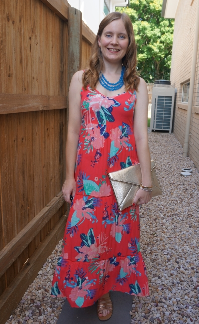 Kmart Tropicana sleeveless tiered maxi dress with blue resin necklace and rebecca minkoff champagne gold leo envelope clutch | awayfromblue