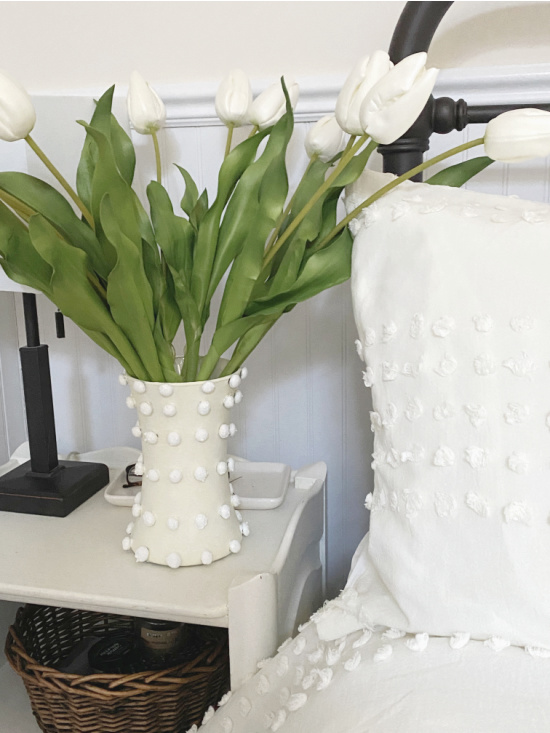 Matching chenille vase next to chenille bed set