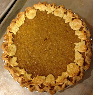 pumpkin pie with fallen leaves garnish
