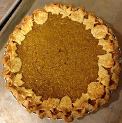 pumpkin pie with fallen leaves garnish