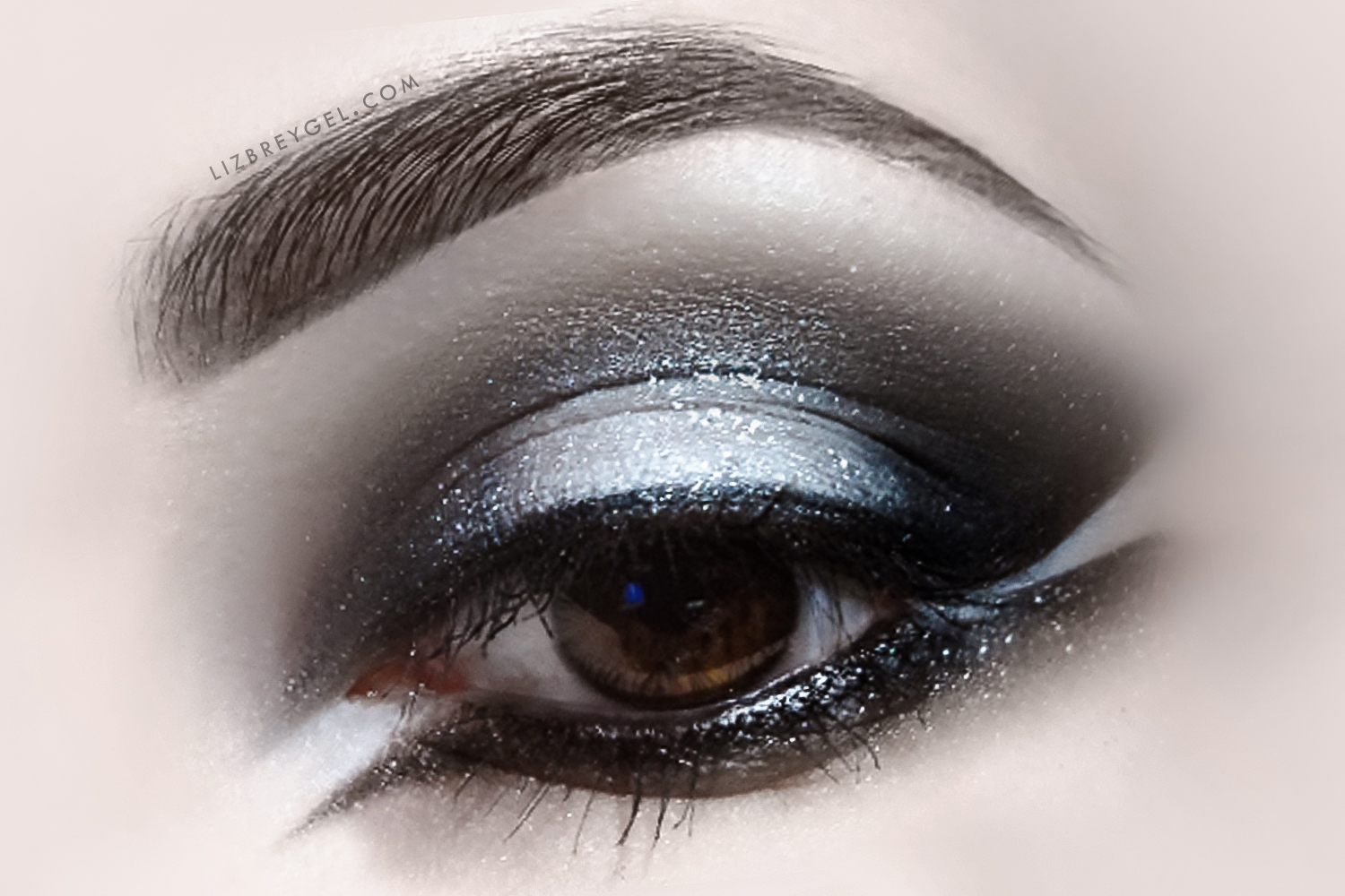 a close up picture of dark, gothic eye makeup look