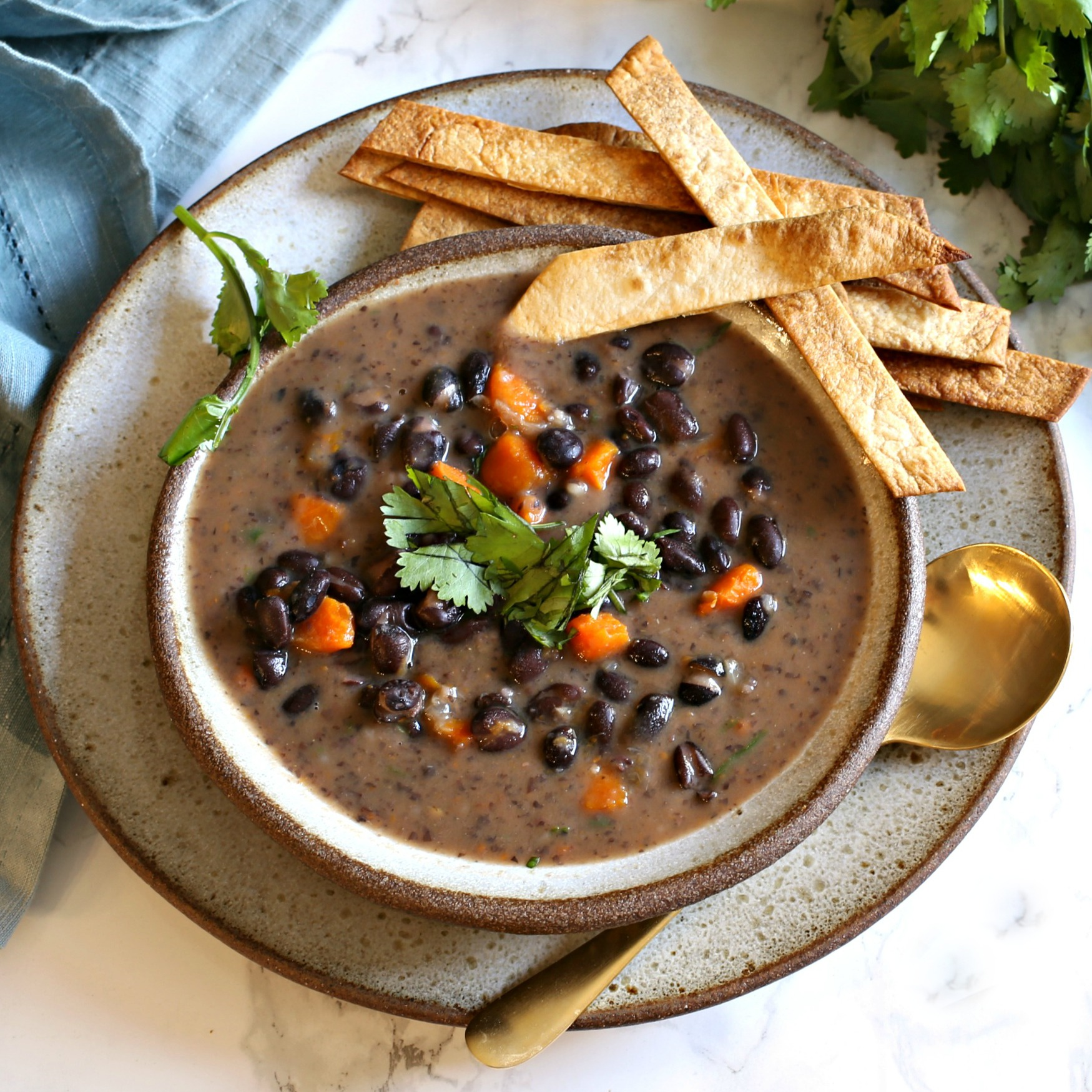 Recipe for soup made with onions, carrots, black beans, cumin and chicken stock.