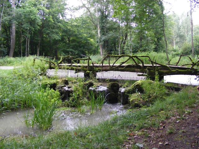 A 19C bridge with faux wood rails, Indre et Loire, France. Photo by Loire Valley Time Travel.