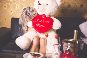 K'Mich Weddings - wedding planning - engagement tips - woman hugging teddy bear