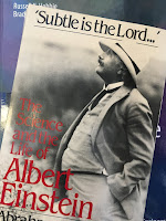 'Subtle is the Lord...':  The Science and Life  of Albert Einstein,  by Abraham Pais, superimposed on Intermediate Physics for Medicine and Biology.