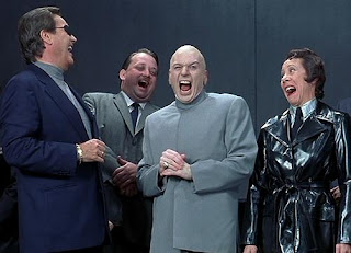 Dr. Evil and 3 other characters from the Austin Powers movies laughing it up.