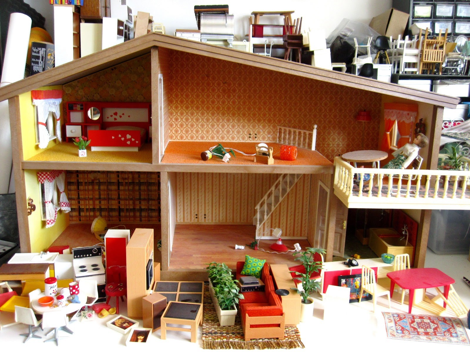 1975 Lundby dolls' house, with a selection of non-Lundby furniture in front of it.