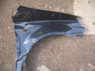car-front-wing-dented