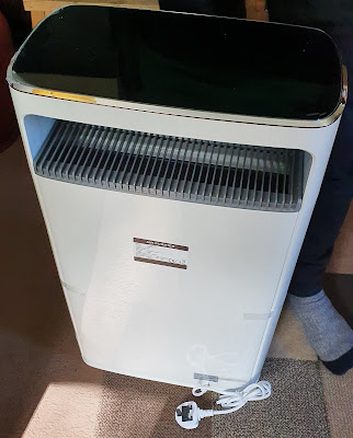 Air purifier full frontal with length of cable and plug shown
