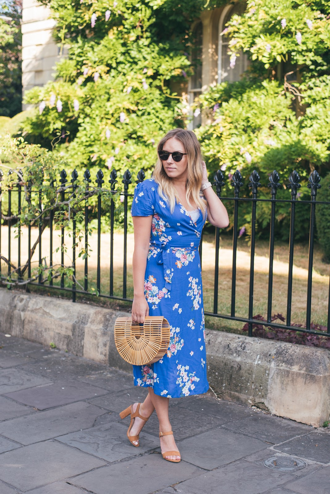 Rachel Emily Walking in the Primark Blue Floral midi Wrap Dress that you need in your wardrobe