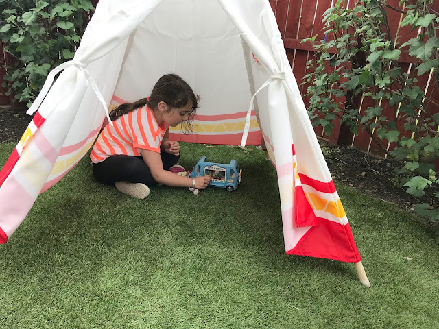hpe child teepee set up in the garden on grass