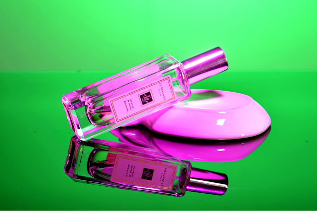 Jo Malone Perfume Bottle In Different Coloured Lights