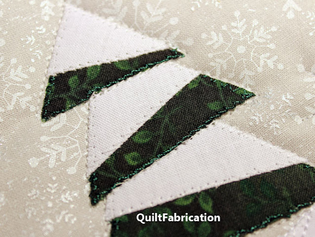 applique stitching around a pine tree