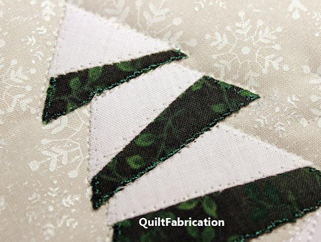 applique stitching around a pine tree