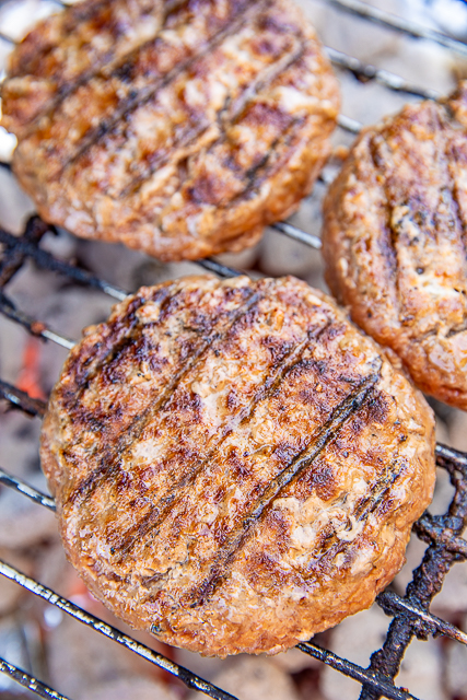 hamburgers cooking on a grill