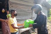 Kompi 2 Batalyon A pelapor mengadakan BHakti sosial membagikan sembako kepada warga yang kurang mampu ditengah pandemik covid -19