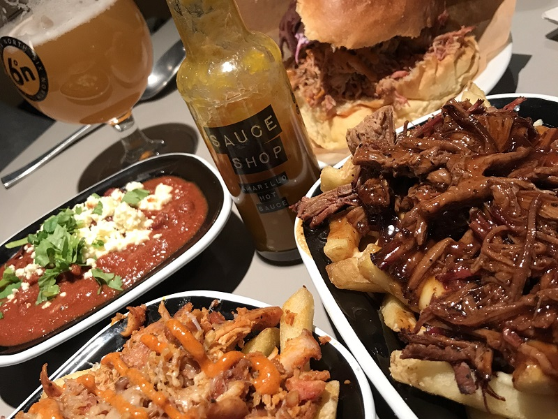 Brisket topped poutine, veggie chilli and pulled pork sandwich from Smoke and Soul