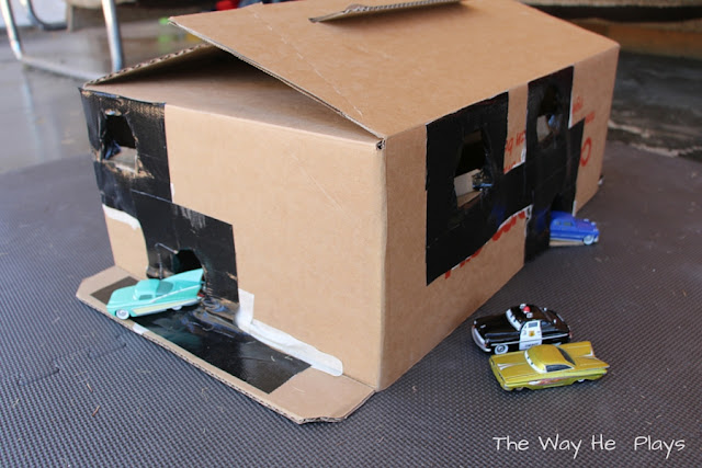 Cardboard box with toy cars