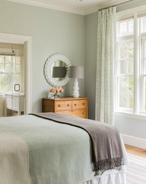 cozy bedroom with walls painted in Benjamin Moore Quiet Moments