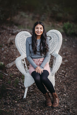 Teenager posing for Christmas mini sessions with Morning Owl Fine Art Photography located in San Diego.