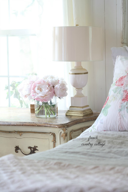 blush lamp with flowers on french nightstand