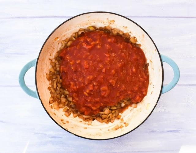 How to make marinara sauce -step 3 - chopped tomatoes, added to the pan